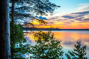 Fototapeta Wschód / zachód słońca Sunset over ocean cove in Mount Desert Island near Acadia National Park, in Maine, USA
