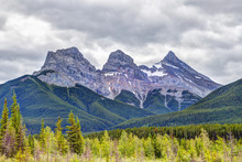 Three Sisters Mountain Peaks In The Canadian Rockies Of Canmore, Alberta, Canada