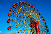 Red Ferris Wheel With Blue Sky