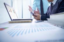 Businessmen Reviewing Financia...