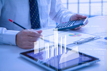 Businessman Or Analyst Holding Calculator While Reviewing Financial Statements For Business Performance Or Cash Flow Analysis
