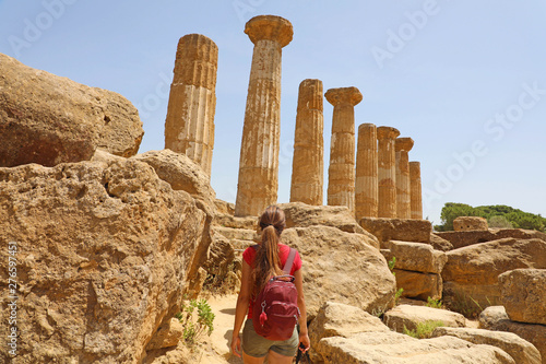 Young woman walking in the Valley of the Temples Agrigento, Sicily Wallpaper Mural