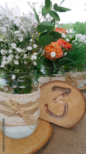 Table Number Three Decorated With White Daisy Flowers And
