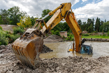 Excavator(construction Equipment) Drowned On The Lake While Working To Strengthen The Shore. Safety Violation. Emergency At Construction Site