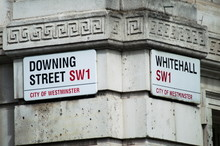 Downing Street Sign In A Corner Of London, England