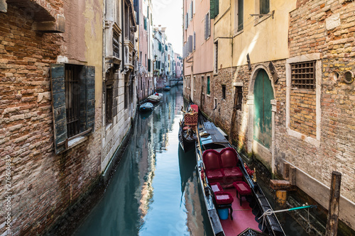 Canvas Prints Venice VENICE, ITALY - JAN 1, 2016: Water Canal of Venice, Italy. Narrow Streets of Venice. Water transportation, gondola, boats. Architecture buildings of Italy.