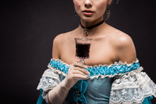 Cropped View Of Victorian Woman Holding Wine Glass On Black
