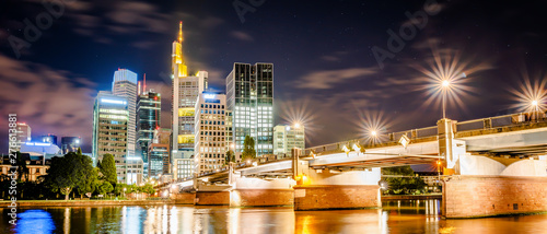 Skyline of Frankfurt with the river Main at night