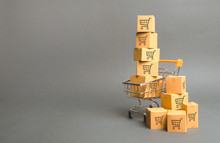 Shopping Cart And Boxes With Drawing Of Smaller Carts. Goods Sale. Commerce, Online Shopping. Purchasing Power, Delivery Order. E-commerce, Sales And Sale Of Goods Through Online Trading Platforms.