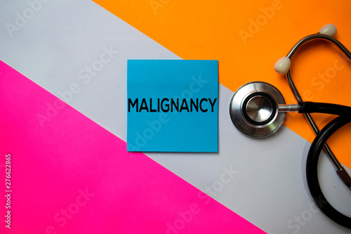 Foto auf Gartenposter Rosa Malignancy text on sticky notes with color office desk. Healthcare/Medical concept