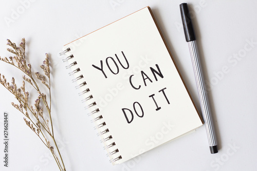 Written words you can do it on paper notebook with pen on white background.