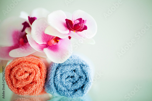 Canvas Prints Zen Colored towels and orchid on white table with copy space on bath room background