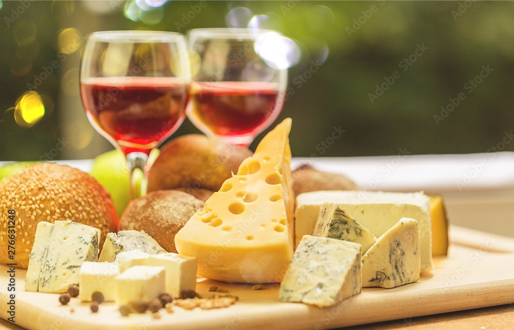 Fototapety, obrazy: Assortment of cheese on board and two glasses of wine