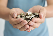 Coins In Two Hands. Concept Mo...