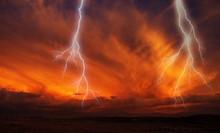 Lightnings Striking Towards The Ground. Lightnings During A Thunderstorm On A Sunset. Scenic Landscape