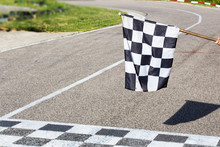 The Finish Line And Checkered Flag Racing. Finish The Race