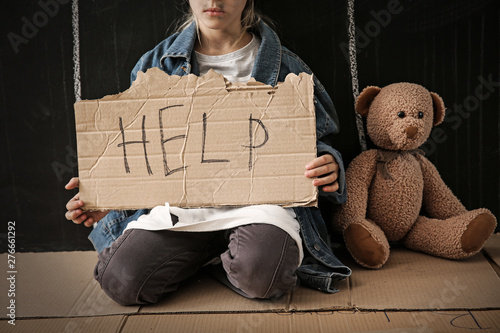 Fényképezés  Homeless little girl begging for help near dark wall