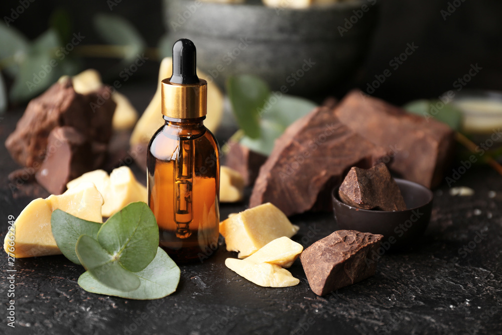 Fototapety, obrazy: Cocoa butter oil on dark table