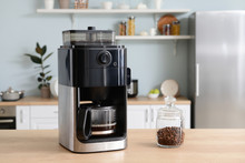 Modern Coffee Machine On Table In Kitchen