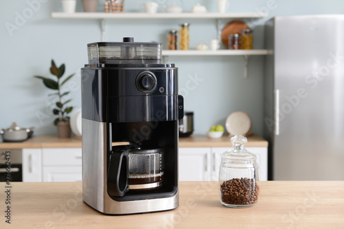 Fotografija Modern coffee machine on table in kitchen