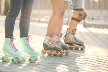 Teenagers On Roller Skates Out...