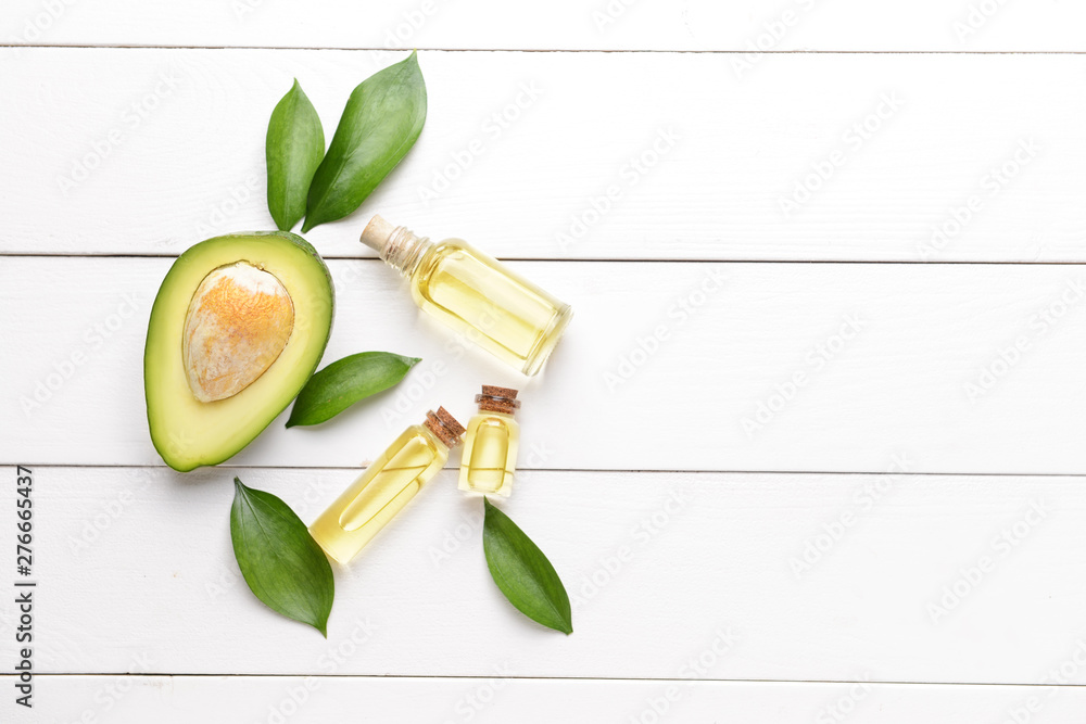 Fototapety, obrazy: Fresh ripe avocados with essential oil on white wooden background