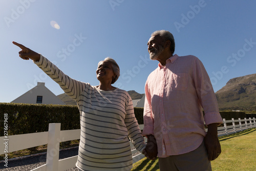 Senior woman with senior man pointing at distance