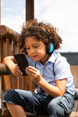 Schoolgirl using mobile phone in the school playground