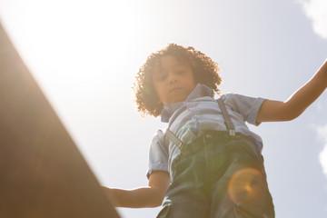 Schoolgirl walking on a bridge in the school playground