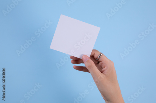 Hand holding a post-it note