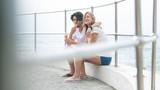 Caucasian couple siting at promenade while having ice cream cone