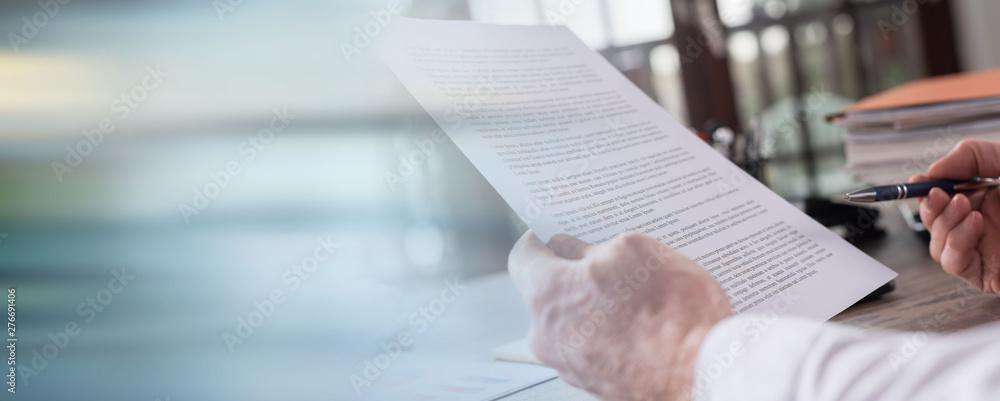 Fototapeta Checking a document; panoramic banner