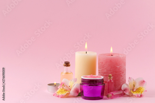 Poster Spa Spa. Aromatherapy. Body care cosmetics. aroma oils and cream on a gentle pink background