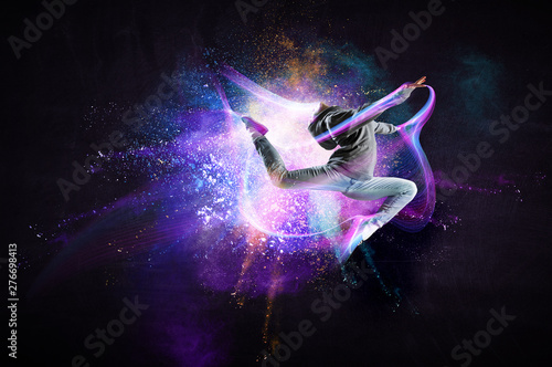Tuinposter Dance School Modern female dancer jumping in hoodie with colourful splashes background. Mixed media
