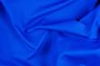 Leinwanddruck Bild - Bright blue fabric texture with folds.
