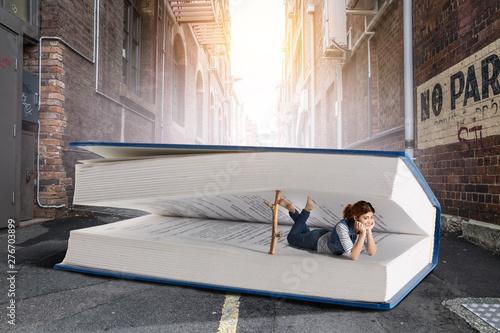 Fotografie, Obraz  Little woman with large book concept