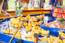 Rubber Yellow Ducks With Hooks In Their Heads. Fairground Hook A Rubber Duck Chance Game