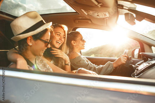Three best female friends travel together Fototapeta