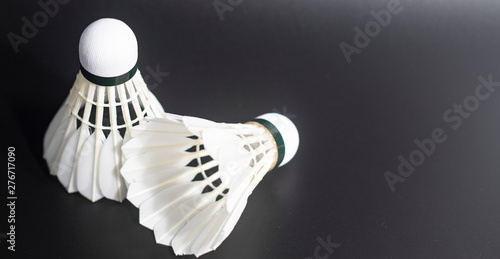 white badminton shuttlecocks lay on black table background Canvas Print