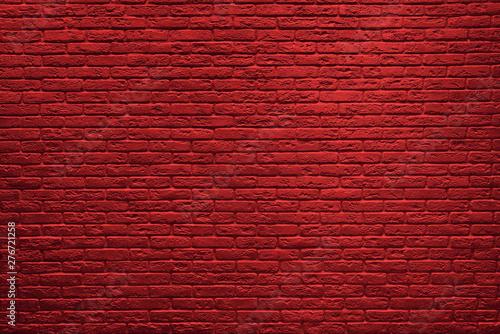 Tło z czerwonej cegły ściany.