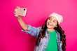 Leinwandbild Motiv Portrait positive cheerful satisfied kid have holiday summer travel use user gadget make photos chill hold hand social network blog blogger video call stylish outfit isolated pink background