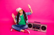 canvas print picture - Full length body size photo beautiful little small she her curly lady enjoy modern playlist sit old tape audio recorder legs crossed wear specs hat casual jeans denim jacket isolated pink background