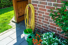 A Garden Yellow Hose Connected...