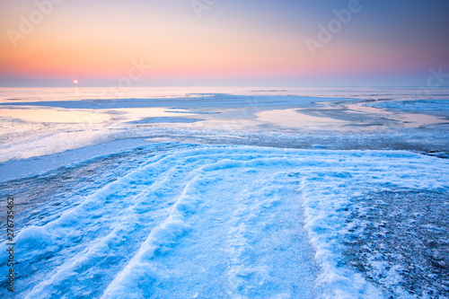 Obraz na plátně  A polar landscape in winter with ice and snow and a colourful landscape