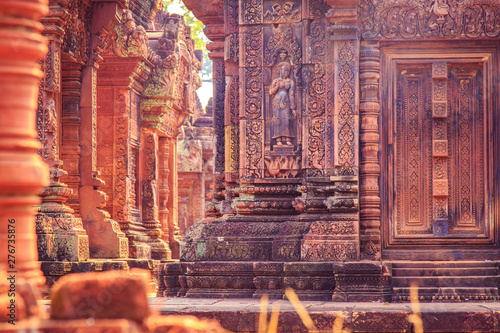 Celestial maiden carved into the red sandstone walls, Banteay Srei temple, Angkor, Cambodia Wallpaper Mural