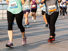 Runners Racing On A Boardwalk From The Waist Down