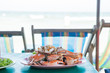 canvas print picture - Steamed crabs on a plate on the table.