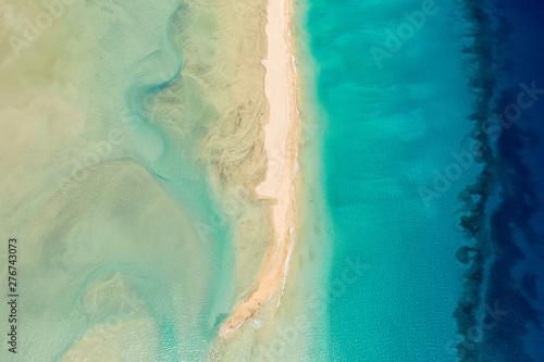Foto auf Leinwand Olivgrun Aerial View Of Turquoise Lagoon And Blue Ocean
