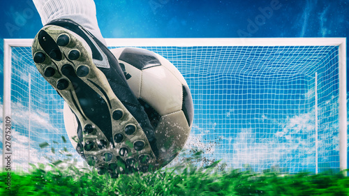 Fototapeta Football scene at night match with close up of a soccer shoe hitting the ball with power obraz