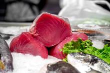 Fresh Raw Tuna Slice With Lemon On Fishmonger